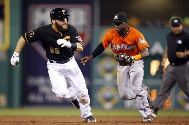 Aug 7, 2014; Pittsburgh, PA, USA; Miami Marlins shortstop Adeiny Hechavarria (middle) chases Pittsburgh Pirates catcher Russell Martin (55) in a run down during the fifth inning at PNC Park. Mandatory Credit: Charles LeClaire-USA TODAY Sports