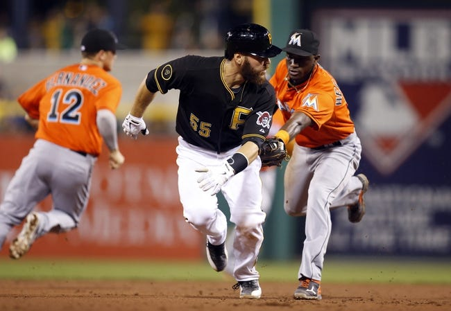 Aug 7, 2014; Pittsburgh, PA, USA; Miami Marlins shortstop Adeiny Hechavarria (right) tags out Pittsburgh Pirates catcher Russell Martin (55) in a run down during the fifth inning at PNC Park. Mandatory Credit: Charles LeClaire-USA TODAY Sports