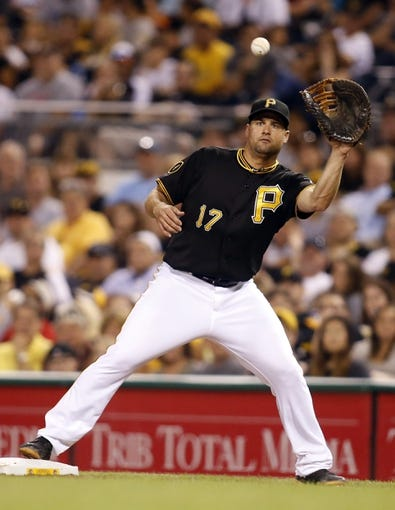 Aug 7, 2014; Pittsburgh, PA, USA; Pittsburgh Pirates first baseman Gaby Sanchez (17) receives the ball at first base to record an out against the Miami Marlins during the seventh inning at PNC Park. Mandatory Credit: Charles LeClaire-USA TODAY Sports