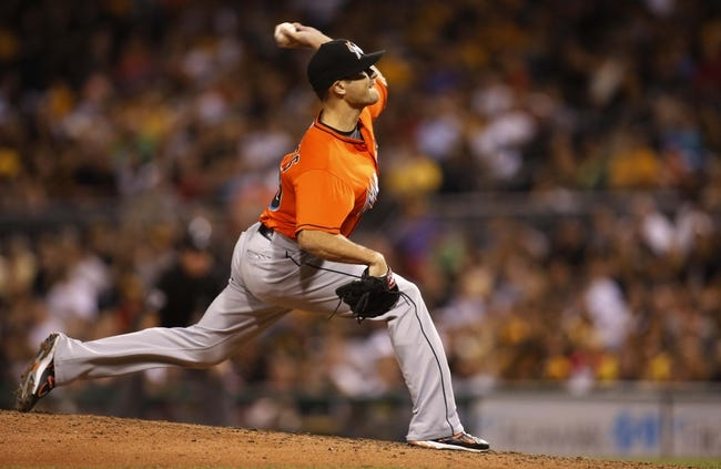 Aug 7, 2014; Pittsburgh, PA, USA; Miami Marlins relief pitcher Dan Jennings (43) pitches against the Pittsburgh Pirates during the seventh inning at PNC Park. Mandatory Credit: Charles LeClaire-USA TODAY Sports