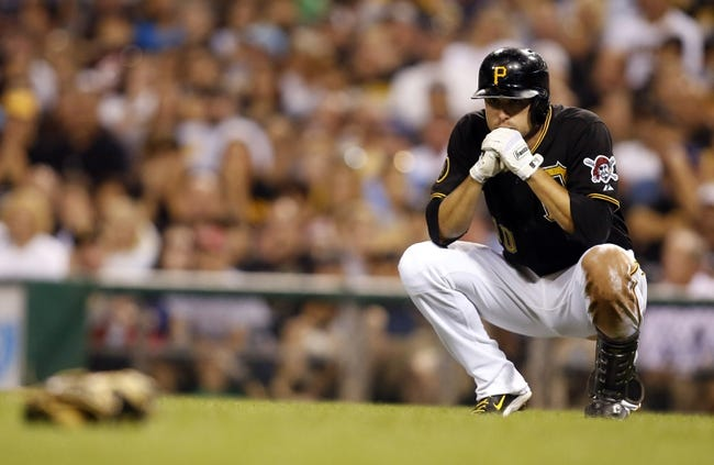 Aug 7, 2014; Pittsburgh, PA, USA; Pittsburgh Pirates shortstop Jordy Mercer (10) reacts after hitting a line drive off the head of Miami Marlins relief pitcher Dan Jennings (not pictured) during the seventh inning at PNC Park. Mandatory Credit: Charles LeClaire-USA TODAY Sports