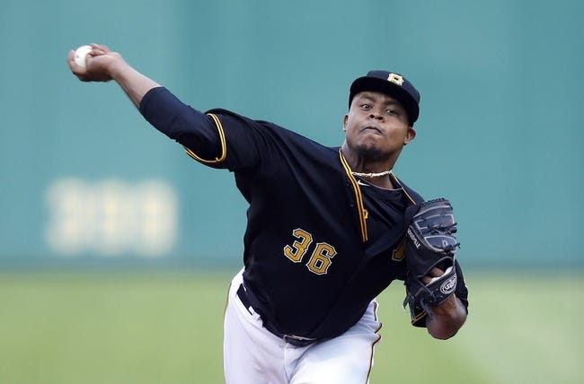 Aug 7, 2014; Pittsburgh, PA, USA; Pittsburgh Pirates starting pitcher Edinson Volquez (36) delivers a pitch against the Miami Marlins during the second inning at PNC Park. The Pirates won 7-2. Mandatory Credit: Charles LeClaire-USA TODAY Sports