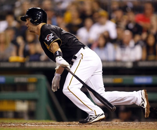 Aug 7, 2014; Pittsburgh, PA, USA; Pittsburgh Pirates third baseman Jayson Nix (27) hits a single against the Miami Marlins during the eighth inning at PNC Park. The Pirates won 7-2. Mandatory Credit: Charles LeClaire-USA TODAY Sports