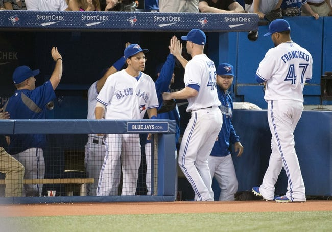 Aug 7, 2014; Toronto, Ontario, CAN; Toronto Blue Jays starting pitcher J.A. Happ (48) is congratulated after leaving the eighth inning in a game against the Baltimore Orioles at Rogers Centre. The Baltimore Orioles won 2-1. Mandatory Credit: Nick Turchiaro-USA TODAY Sports
