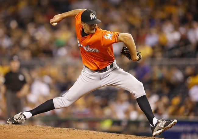 Aug 7, 2014; Pittsburgh, PA, USA; Miami Marlins relief pitcher Steve Cishek (31) pitches against the Pittsburgh Pirates during the eighth inning at PNC Park. The Pirates won 7-2. Mandatory Credit: Charles LeClaire-USA TODAY Sports