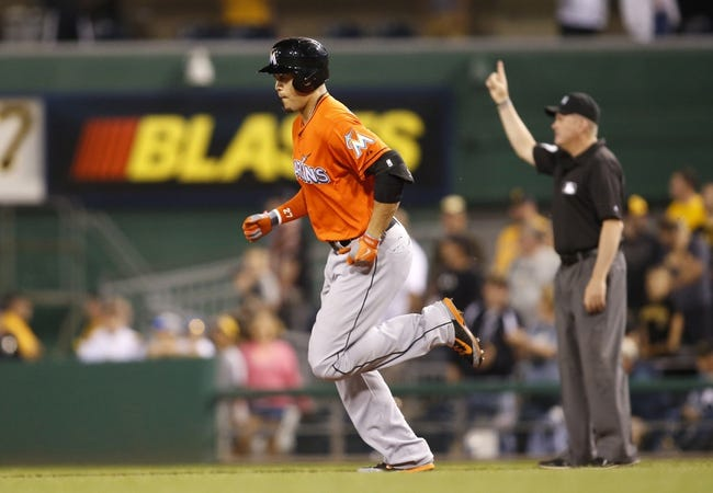 Aug 7, 2014; Pittsburgh, PA, USA; Miami Marlins right fielder Giancarlo Stanton (left) rounds the bases after hitting a two run home run against the Pittsburgh Pirates during the ninth inning at PNC Park. The Pirates won 7-2. Mandatory Credit: Charles LeClaire-USA TODAY Sports