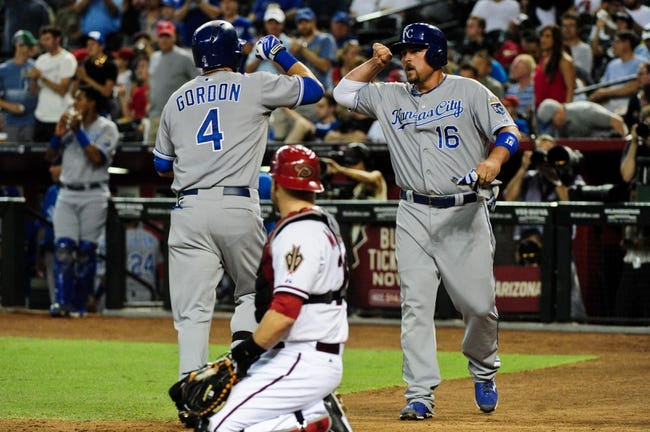 Aug 7, 2014; Phoenix, AZ, USA; Kansas City Royals left fielder Alex Gordon (4) celebrates with designated hitter Billy Butler (16) after hitting a two run home run as Arizona Diamondbacks catcher Miguel Montero (26) looks on during the second inning at Chase Field. Mandatory Credit: Matt Kartozian-USA TODAY Sports