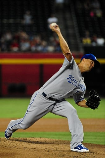 Aug 7, 2014; Phoenix, AZ, USA; Kansas City Royals starting pitcher Jeremy Guthrie (11) throws during the first inning against the Arizona Diamondbacks at Chase Field. Mandatory Credit: Matt Kartozian-USA TODAY Sports