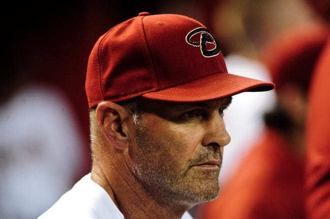 Aug 7, 2014; Phoenix, AZ, USA; Arizona Diamondbacks manager Kirk Gibson (23)  looks on during the second inning against the Kansas City Royals at Chase Field. Mandatory Credit: Matt Kartozian-USA TODAY Sports