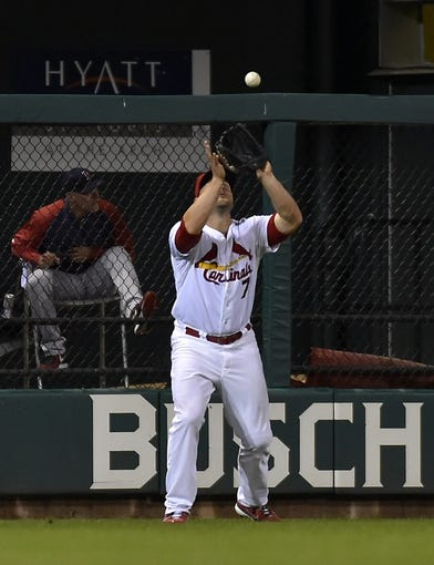 Aug 7, 2014; St. Louis, MO, USA;  St. Louis Cardinals left fielder Matt Holliday (7) catches a fly ball for an out against the Boston Red Sox at Busch Stadium. Mandatory Credit: Jasen Vinlove-USA TODAY Sports