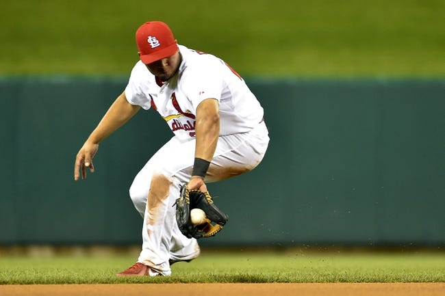 Aug 7, 2014; St. Louis, MO, USA;  St. Louis Cardinals shortstop Jhonny Peralta (27) fields a ground ball for an out against the Boston Red Sox at Busch Stadium. Mandatory Credit: Jasen Vinlove-USA TODAY Sports