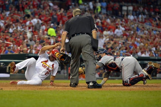 Aug 7, 2014; St. Louis, MO, USA;  St. Louis Cardinals shortstop Jhonny Peralta (27) scores on a single hit by St. Louis Cardinals right fielder Oscar Taveras (not pictured) against the Boston Red Sox at Busch Stadium. Mandatory Credit: Jasen Vinlove-USA TODAY Sports