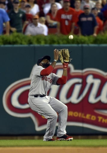 Aug 7, 2014; St. Louis, MO, USA;  Boston Red Sox center fielder Jackie Bradley Jr. (25) makes a catch for an out against the St. Louis Cardinals at Busch Stadium. Mandatory Credit: Jasen Vinlove-USA TODAY Sports