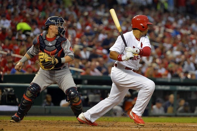 Aug 7, 2014; St. Louis, MO, USA;  St. Louis Cardinals center fielder Jon Jay (19) hits a single against the Boston Red Sox at Busch Stadium. Mandatory Credit: Jasen Vinlove-USA TODAY Sports