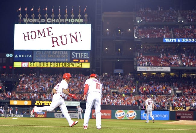 Aug 7, 2014; St. Louis, MO, USA;  St. Louis Cardinals second baseman Kolten Wong (16) rounds 3rd base after hitting a home run against the Boston Red Sox at Busch Stadium. Mandatory Credit: Jasen Vinlove-USA TODAY Sports
