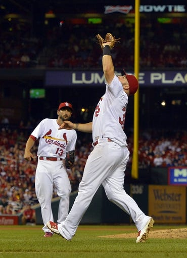 Aug 7, 2014; St. Louis, MO, USA;  St. Louis Cardinals first baseman Matt Adams (32) catches a pop fly for an out against the Boston Red Sox at Busch Stadium. Mandatory Credit: Jasen Vinlove-USA TODAY Sports