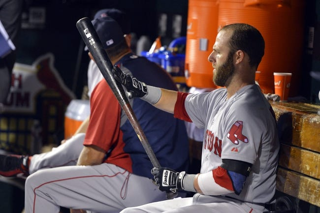 Aug 7, 2014; St. Louis, MO, USA;  Boston Red Sox second baseman Dustin Pedroia (15) sits in the dugout during the game between the St. Louis Cardinals and the Boston Red Sox at Busch Stadium. Mandatory Credit: Jasen Vinlove-USA TODAY Sports