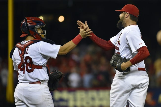 Aug 7, 2014; St. Louis, MO, USA; St. Louis Cardinals catcher Tony Cruz (48) and relief pitcher Pat Neshek (37) celebrate after defeating the Boston Red Sox 5-2 at Busch Stadium. Mandatory Credit: Jasen Vinlove-USA TODAY Sports