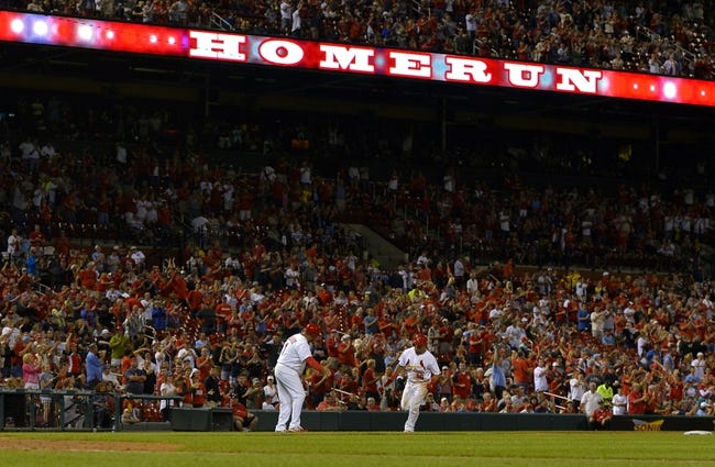 Aug 7, 2014; St. Louis, MO, USA;  St. Louis Cardinals second baseman Kolten Wong (16) rounds third base after hitting his second home run of the night against the Boston Red Sox at Busch Stadium. Mandatory Credit: Jasen Vinlove-USA TODAY Sports
