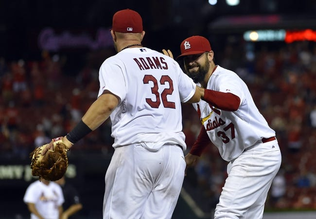 Aug 7, 2014; St. Louis, MO, USA; St. Louis Cardinals first baseman Matt Adams (32) and relief pitcher Pat Neshek (37) celebrate deleting the Boston Red Sox 5-2 at Busch Stadium. Mandatory Credit: Jasen Vinlove-USA TODAY Sports