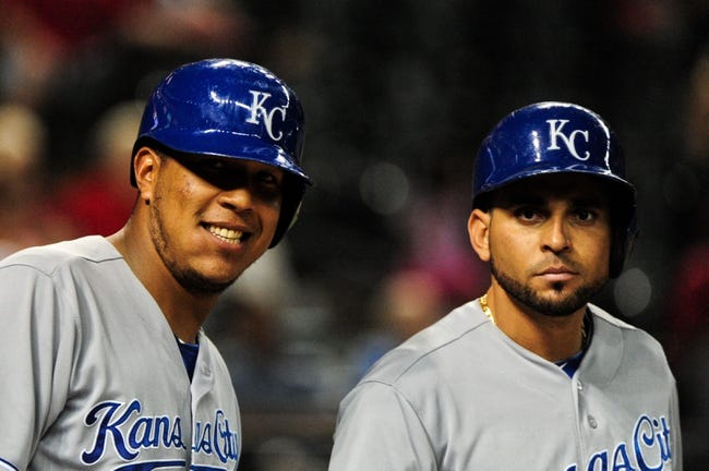 Aug 7, 2014; Phoenix, AZ, USA; Kansas City Royals catcher Salvador Perez (13) and second baseman Omar Infante (14) pose during the ninth inning against the Arizona Diamondbacks at Chase Field. Mandatory Credit: Matt Kartozian-USA TODAY Sports