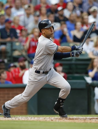 Jul 28, 2014; Arlington, TX, USA; New York Yankees shortstop Derek Jeter (2) hits during the game against the Texas Rangers at Globe Life Park in Arlington. Mandatory Credit: Kevin Jairaj-USA TODAY Sports