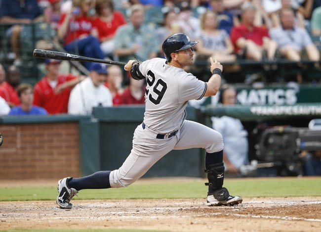 Jul 28, 2014; Arlington, TX, USA; New York Yankees catcher Francisco Cervelli (29) hits during the game against the Texas Rangers at Globe Life Park in Arlington. Mandatory Credit: Kevin Jairaj-USA TODAY Sports