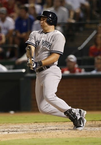 Jul 28, 2014; Arlington, TX, USA; New York Yankees first baseman Mark Teixeira (25) hits during the game against the Texas Rangers at Globe Life Park in Arlington. Mandatory Credit: Kevin Jairaj-USA TODAY Sports