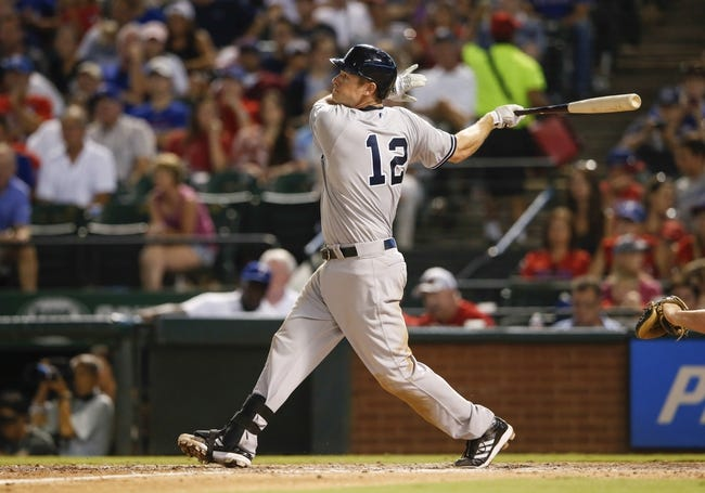 Jul 28, 2014; Arlington, TX, USA; New York Yankees third baseman Chase Headley (12) hits during the game against the Texas Rangers at Globe Life Park in Arlington. Mandatory Credit: Kevin Jairaj-USA TODAY Sports