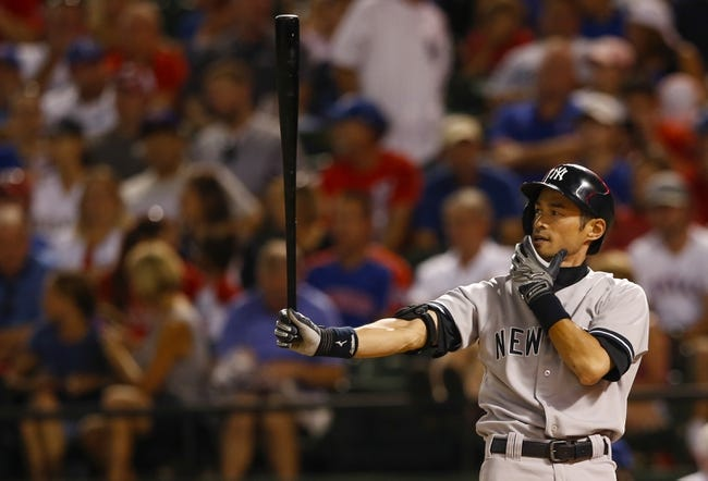 Jul 28, 2014; Arlington, TX, USA; New York Yankees right fielder Ichiro Suzuki (31) hits during the game against the Texas Rangers at Globe Life Park in Arlington. Mandatory Credit: Kevin Jairaj-USA TODAY Sports