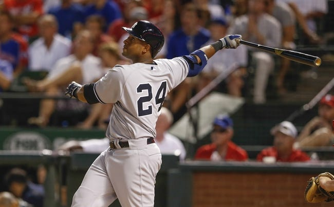 Jul 28, 2014; Arlington, TX, USA; New York Yankees left fielder Zoilo Almonte (24) hits during the game against the Texas Rangers at Globe Life Park in Arlington. Mandatory Credit: Kevin Jairaj-USA TODAY Sports