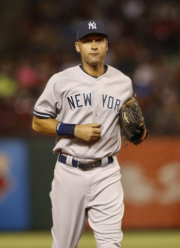 Jul 28, 2014; Arlington, TX, USA; New York Yankees shortstop Derek Jeter (2) during the game against the Texas Rangers at Globe Life Park in Arlington. Mandatory Credit: Kevin Jairaj-USA TODAY Sports