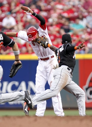 Aug 8, 2014; Cincinnati, OH, USA; Cincinnati Reds center fielder Billy Hamilton (6) is caught in a run down by Miami Marlins shortstop Adeiny Hechavarria (3) during the first inning at Great American Ball Park. Mandatory Credit: Frank Victores-USA TODAY Sports