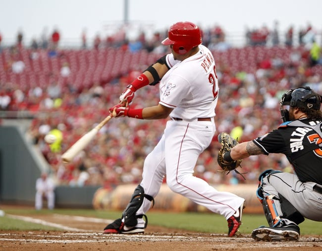 Aug 8, 2014; Cincinnati, OH, USA; Cincinnati Reds catcher Brayan Pena (29) singles during the first inning against the Miami Marlins at Great American Ball Park. Mandatory Credit: Frank Victores-USA TODAY Sports