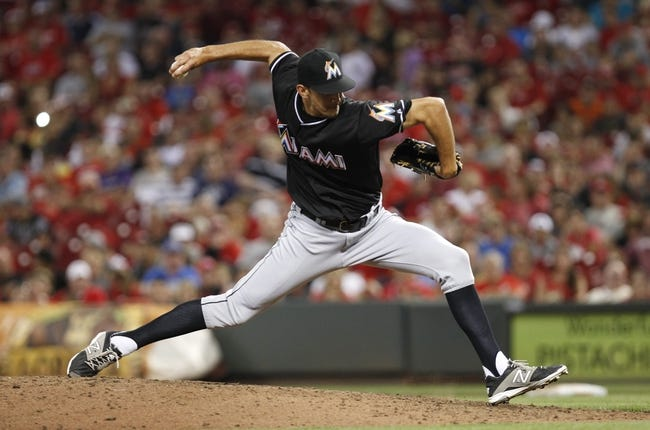 Aug 8, 2014; Cincinnati, OH, USA; Miami Marlins relief pitcher Steve Cishek (31) pitches during the ninth inning against the Cincinnati Reds at Great American Ball Park. The Marlins won 2-1. Mandatory Credit: Frank Victores-USA TODAY Sports