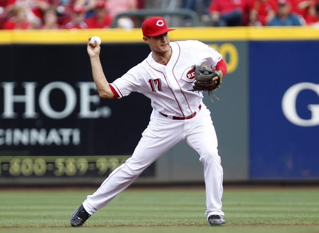 Aug 8, 2014; Cincinnati, OH, USA; Cincinnati Reds second baseman Kris Negron (17) fields a ball during the second inning against the Miami Marlins at Great American Ball Park. The Marlins won 2-1. Mandatory Credit: Frank Victores-USA TODAY Sports