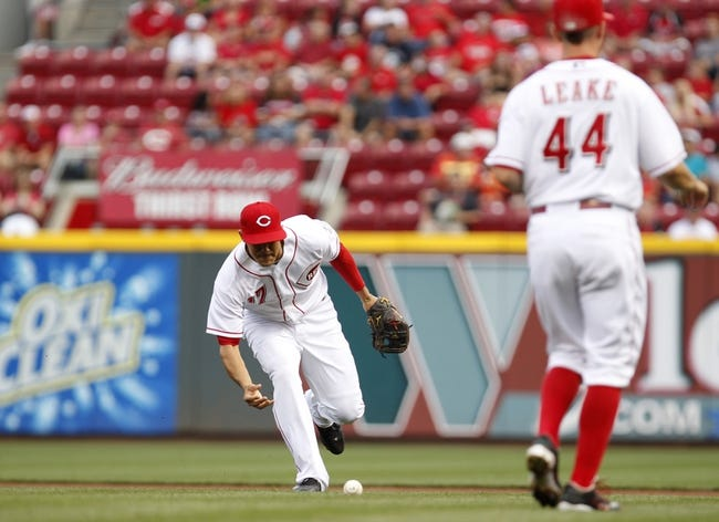 Aug 8, 2014; Cincinnati, OH, USA; Cincinnati Reds second baseman Kris Negron (17) fields a ball during the first inning against the Miami Marlins at Great American Ball Park. The Marlins won 2-1. Mandatory Credit: Frank Victores-USA TODAY Sports