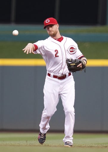 Aug 8, 2014; Cincinnati, OH, USA; Cincinnati Reds shortstop Zack Cozart (2) throws the ball during the third inning against the Miami Marlins at Great American Ball Park. The Marlins won 2-1. Mandatory Credit: Frank Victores-USA TODAY Sports