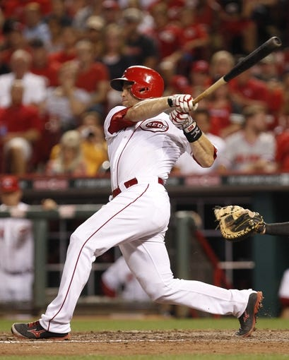 Aug 8, 2014; Cincinnati, OH, USA; Cincinnati Reds catcher Devin Mesoraco (39) doubles during the ninth inning against the Miami Marlins at Great American Ball Park. The Marlins won 2-1. Mandatory Credit: Frank Victores-USA TODAY Sports