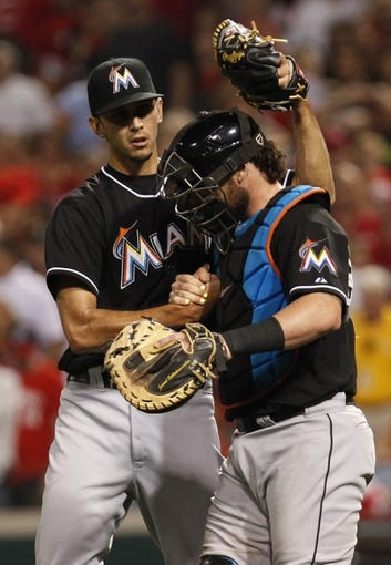 Aug 8, 2014; Cincinnati, OH, USA; Miami Marlins relief pitcher Steve Cishek (31) celebrates with catcher Jarrod Saltalamacchia (39) after their game against the Cincinnati Reds at Great American Ball Park. The Marlins won 2-1. Mandatory Credit: Frank Victores-USA TODAY Sports