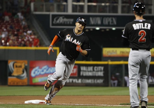 Aug 8, 2014; Cincinnati, OH, USA; Miami Marlins right fielder Giancarlo Stanton (27) rounds third base after hitting a home run during the seventh inning against the Cincinnati Reds at Great American Ball Park. The Marlins won 2-1. Mandatory Credit: Frank Victores-USA TODAY Sports