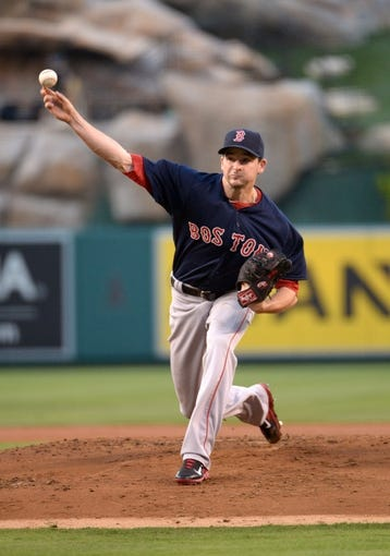 Aug 8, 2014; Anaheim, CA, USA; Boston Red Sox starter Allen Webster (64) delivers a pitch against the Los Angeles Angels at Angel Stadium of Anaheim. Mandatory Credit: Kirby Lee-USA TODAY Sports