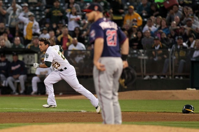 Aug 8, 2014; Oakland, CA, USA; Oakland Athletics center fielder Sam Fuld (23) runs to second base after a collisionwith Minnesota Twins first baseman Chris Parmelee (not pictured) in the fifth inning against the Minnesota Twins at O.co Coliseum. Mandatory Credit: Lance Iversen-USA TODAY Sports