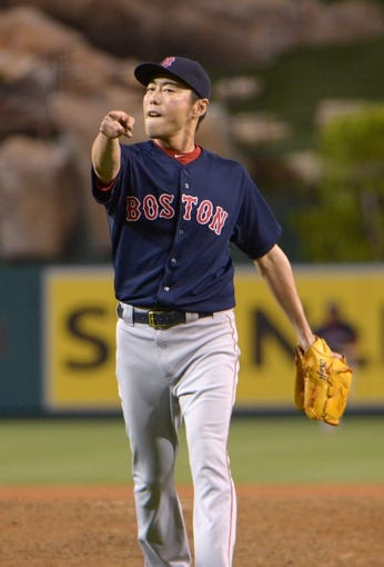 Aug 8, 2014; Anaheim, CA, USA; Boston Red Sox reliever Koji Uehara (19) reacts after the final out against the Los Angeles Angels at Angel Stadium of Anaheim. The Red Sox won 4-2. Mandatory Credit: Kirby Lee-USA TODAY Sports