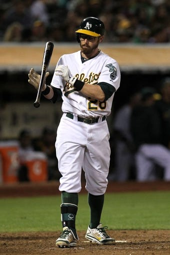 Aug 8, 2014; Oakland, CA, USA; Oakland Athletics shortstop Eric Sogard (28) flips his bat after striking out in the eighth inning of their MLB baseball game with the Minnesota Twins at O.co Coliseum. The Athletics won 6-5. Mandatory Credit: Lance Iversen-USA TODAY Sports.