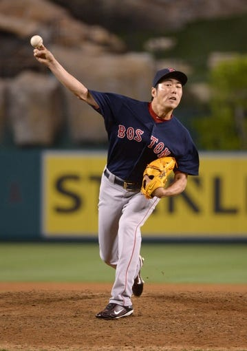 Aug 8, 2014; Anaheim, CA, USA; Boston Red Sox reliever Koji Uehara (19) delivers a pitch in the ninth inning against the Los Angeles Angels at Angel Stadium of Anaheim. The Red Sox won 4-2. Mandatory Credit: Kirby Lee-USA TODAY Sports