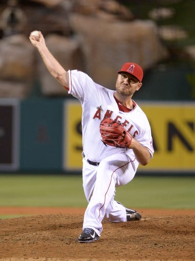 Aug 8, 2014; Anaheim, CA, USA; Los Angeles Angels reliever Kevin Jepsen (40) delivers a pitch against the Boston Red Sox at Angel Stadium of Anaheim. The Red Sox won 4-2. Mandatory Credit: Kirby Lee-USA TODAY Sports