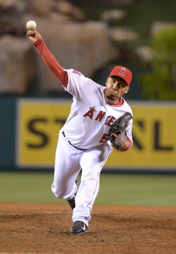Aug 8, 2014; Anaheim, CA, USA; Los Angeles Angels reliever Fernando Salas (59) delivers a pitch against the Boston Red Sox at Angel Stadium of Anaheim. The Red Sox won 4-2. Mandatory Credit: Kirby Lee-USA TODAY Sports