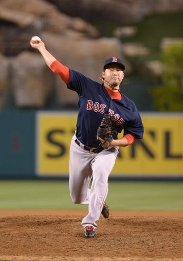 Aug 8, 2014; Anaheim, CA, USA; Boston Red Sox reliever Junichi Tazawa (36) delivers a pitch against the Los Angeles Angels at Angel Stadium of Anaheim. The Red Sox won 4-2. Mandatory Credit: Kirby Lee-USA TODAY Sports