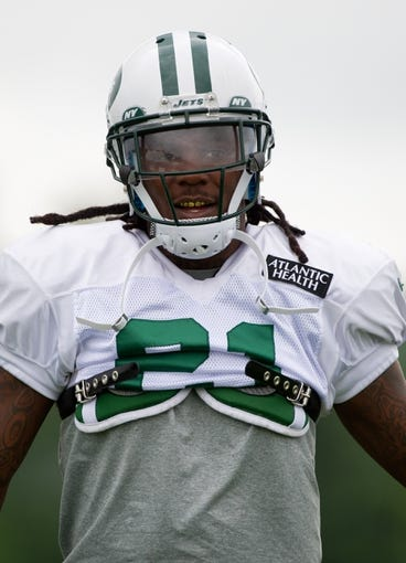 Aug 4, 2014; Cortland, NY, USA; New York Jets running back Chris Johnson (21) looks on during training camp at SUNY Cortland. Mandatory Credit: Rich Barnes-USA TODAY Sports